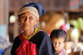 BAM MUANG PAM, THAILAND, NOVEMBER 22 : close portrait of an old Karen tribe woman with his grandson,