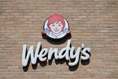 JACKSONVILLE, FL-MAY 17, 2014: A Wendy's Logo at one of their fast food stores in Jacksonville. Wendy's is the world's third largest hamburger fast food chain with approximately 6,650 locations.