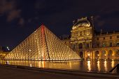 PARIS - MAY 9: Louvre Museum (Musee du Louvre) and the Pyramid in Paris, France, at night illuminati