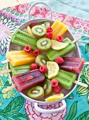 stock photo of popsicle  - Colorful popsicles with fresh fruits in vintage tray - JPG