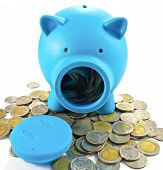 Blue Piggy Bank With Some Coins