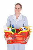 Female Cleaner Holding Chemical Supplies In Basket