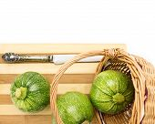 Three Round Zucchinis In With Knife,cutting Board,wicker Basket And Copy-space