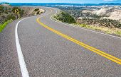 image of twisty  - A two lane road curves along a canyon rim in southern Utah - JPG