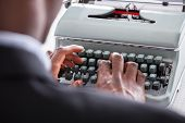 Businessman Typing On Typewriter