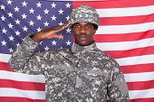 Army Soldier Saluting In Front Of American Flag