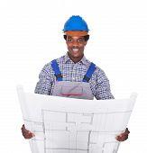 Male Craftsman Holding Blueprint