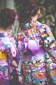 Japanese Women Wear A Traditional Dress Called Kimono For Sakura Viewing At Kiyomizu Temple In Kyoto