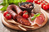 stock photo of antipasto  - mediterranean snack chorizo parma olives tomatoes - JPG