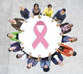 Multiethnic People Holding Hands for Breast Cancer Foundation