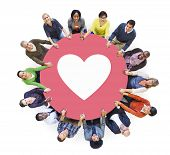 Multiethnic People Holding Hands with Heart Symbol