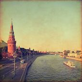 Kremlin and Moscow river in grunge and retro style.