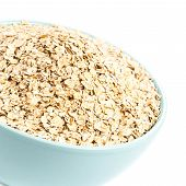 Healthy Homemade Oatmeal Breakfast In A Bowl Close Up. Oat Flakes For Breakfast Isolated  On White B
