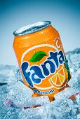 MOSCOW, RUSSIA-APRIL 4, 2014: Can of Coca Cola company soft drink Fanta Orange on ice. Fanta is a gl