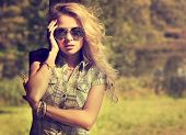 Trendy Hipster Girl on Summer Nature Background