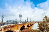 picture of bordeaux  - Old stony bridge in Bordeaux - JPG