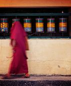 image of himachal pradesh  - Vintage retro effect filtered hipster style travel image of Buddhist monk with prayer beads passing spinning prayer wheels on kora around Tsuglagkhang complex in McLeod Ganj - JPG
