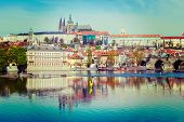 Vintage retro hipster style travel image of  Charles bridge over Vltava river and Gradchany (Prague