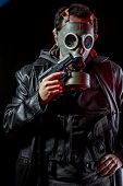 Private detective with bulletproof vest and gas mask, gear