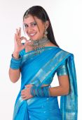 girl with blue silk sari saying excellent