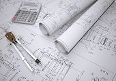 stock photo of mechanical drawing  - Scrolls engineering drawings and tools - JPG
