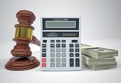 Gavel, wads money and calculator