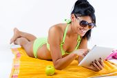 Happy Young Girl With Green Bikini And Digital Table