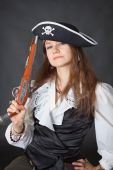 foto of crossed pistols  - Portrait of the beautiful girl in a pirate hat with an ancient pistol in a hand - JPG