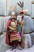 CUZCO, PERU - JULY 13, 2013: man disguised as Inca warrior in the peruvian Andes
