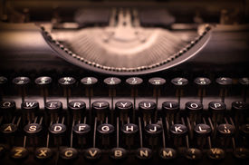 pic of qwerty  - Close up of a dirty vintage typewriter warm filter - JPG