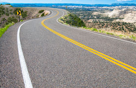 pic of twisty  - A two lane road curves along a canyon rim in southern Utah - JPG