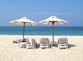 Sun umbrellas and chairs on the Bang Tao beach of Phuket island