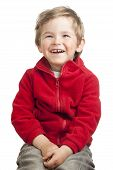 Portrait Of Laughing Blonde Toddler Boy On White