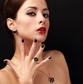 Beautiful Fashion Model With Jewelry Accessories And Black Fingernail Looking Sexy. Red Lips Makeup