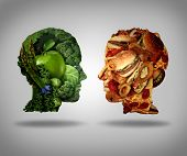 image of competing  - Lifestyle choice and dilemma concept as a two human faces one made of fresh green vegetables and fruit and the other head shaped with greasy fast food as hamburgers and fried foods as a symbol of nutrition facts and healthy living issues - JPG