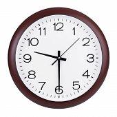 Round Clock Shows Half Past Nine