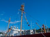 pic of wispy  - Columbia Lightship Nautical and American Flags Hanging with Wispy Clouds - JPG