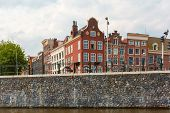 City View Of Amsterdam Canal And Typical Houses, Holland, Netherlands.