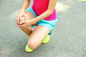 Sports injuries of girl outdoors
