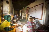 KATHMANDU, NEPAL - DEC 9, 2013: Unknown teacher and students in lesson at Jagadguru School. School established at 2013, to let new generation learn Sanskrit and preserve Hindu culture.