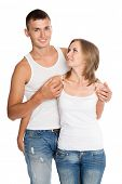 Young man and woman in jeans and wite undershirts