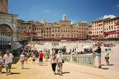 Piazza del Campo in the preparation of the sandy substrate for the place of the Palio horse race, with the Public Palace, Siena, Tuscany, Italy, Editorial for only