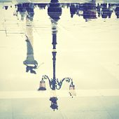 Venice reflects in puddle (Saint Mark's square), Italy. Instagram style filtred image