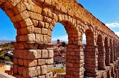 a view of the Roman Aqueduct of Segovia, in Spain