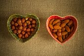 image of sackcloth  - Assorted nuts in dishes in shape of heart on a sackcloth background