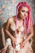 Young Woman With Dreadlocks Wearing Corset