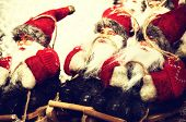 Santa Clauses On Wooden Sledge