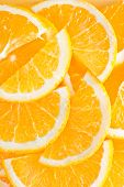 stock photo of valencia-orange  - fresh orange on the yellow plate and on a table - JPG