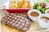 australian wagyu rib-eye beef steak serve with fresh vegetable