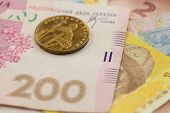 Ukrainian coin and banknotes macro background - hrivna